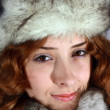 Portrait of girl in arctic fox cap — 图库照片