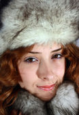 Portrait of girl in arctic fox cap — Stock Photo