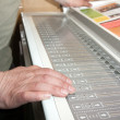Stock Photo: Hands on electronic control panel