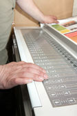 Hands on the electronic control panel — Stock Photo