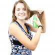 Brunette girl with hair spray - Stock Photo