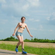 Stock Photo: Young girl on roller blades
