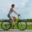 Girl goes on bicycle — Stock Photo
