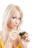 Girl putting facial powder with a brush — Stock Photo