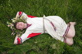 Girl in camomile chaplet — Stock Photo