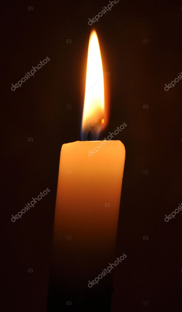 Hot candle in a dark room near-by  Stock Photo #1240059