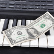 Dolar on an old synthesizer — Stock Photo