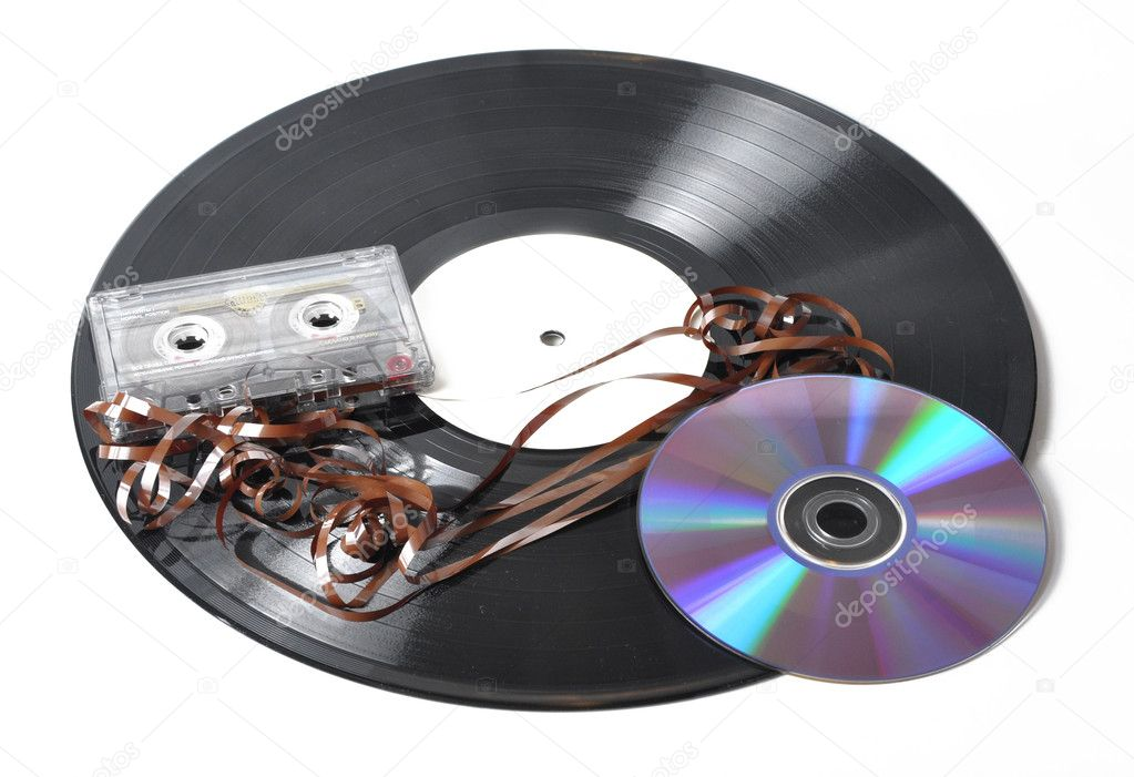 Picture of voice plate audio cassettes and compact disk disk on a white background — Stock Photo #1570485