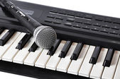 A microphone lying on the keys — Stock Photo