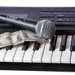 A microphone and dollar - Stock Photo