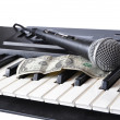 A microphone and dollar — Stock Photo