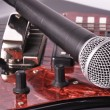 Stock Photo: A microphone lying on a guitar