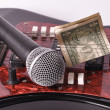 A microphone and dollar — Stock Photo #1710673