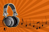 Acoustic earpiecess and musical notes — Stock Photo