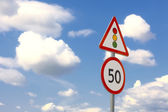 Traffic sign in the dark blue sky with c — Stock Photo