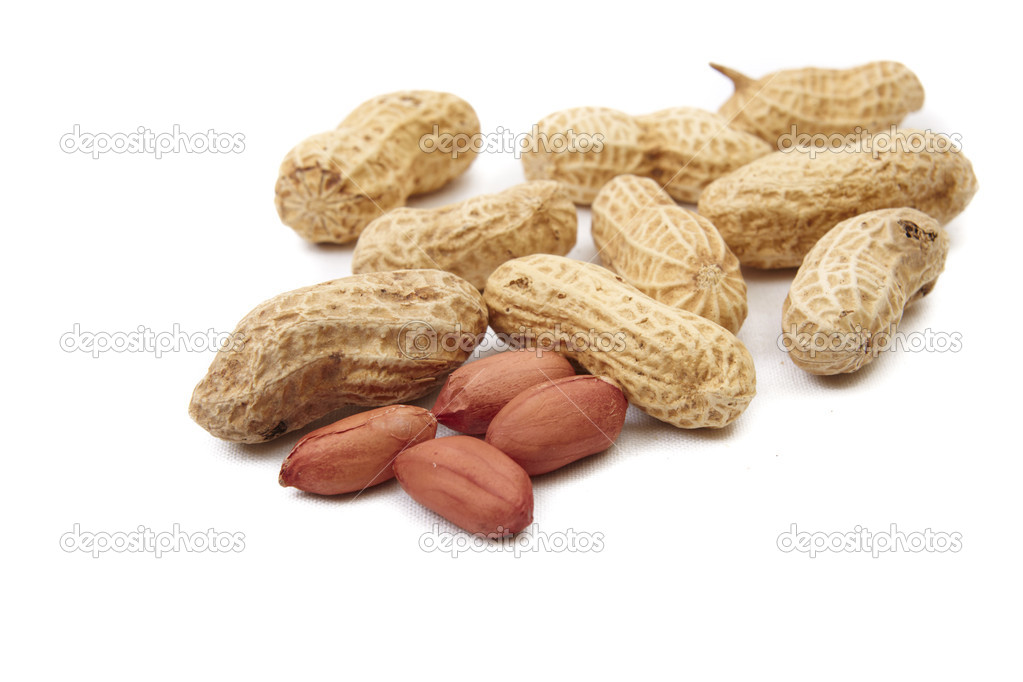 Peanuts cracked open isolated on a white  Stock Photo #1135432