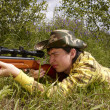 Young hunter shooting up — Stock Photo