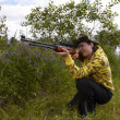 Stock Photo: Young hunter shooting up