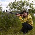 Young hunter shooting up — Stock Photo