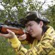 Young hunter shooting up - Stock Photo
