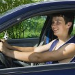 Young men driving a car - Stock Photo