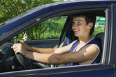 Young men driving a car — Stock Photo
