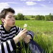 Teenager and dandelion — Stock Photo