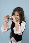 Young girl taking photos — Stock Photo