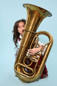 Young girl playing the horn — Stock Photo
