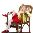 Little girl in a wicker chair — Stock Photo