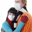 Stock Photo: Man embraces a woman masks