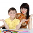 Boy and girl with colored pencils - Stock Photo