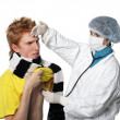 Man getting a flu shot from his doctor - Stock Photo