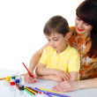 Small boy and a girl with pencils — Stock Photo