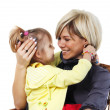 Little girl hugs the young mother — Stock Photo