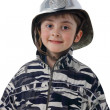 Royalty-Free Stock Photo: Little boy in the old fire helmet