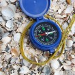 Dark blue compass on sand — Stock Photo #1489104