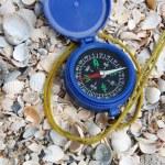 Dark blue compass on sand — Stock Photo
