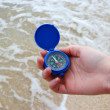 Stock Photo: Dark blue compass in hands