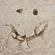 Smile is drawn on marine sand - Foto Stock
