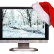 Royalty-Free Stock Photo: Cap of Santa Klaus on the display