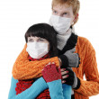 Man embraces a woman wearing masks, flu, — Stock Photo #1491242