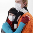 Man embraces a woman wearing masks — Stock Photo