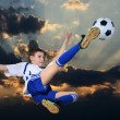 Soccer player against the backdrop of cloudy skies — Stock Photo #1491315