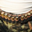 Belt of ammunition on the belt - Stock Photo