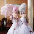 Photo: Two girls in wedding dresses and masks