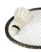 Volants sur une raquette pour un badminton — Photo