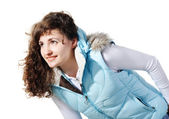 Beautiful young girl in a white woman's jacket and jeans — Stock Photo