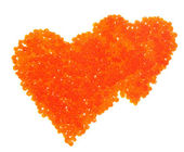 Red caviar in the form of heart — Stock Photo