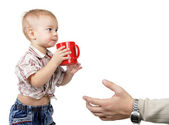Dad takes a little son a red cup — Stock Photo